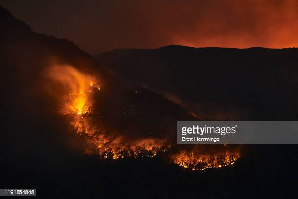 Flames from scattered bushfires are pictured on the horizon on December 04 2019 in Katoomba Australia It is estimated that 20 per cent of the Blue...