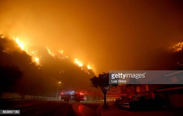 Flames from the Canyon Fire threaten a neighborhood on September 25 2017 in Corona California The fire charred about 1500 acres by Monday evening...