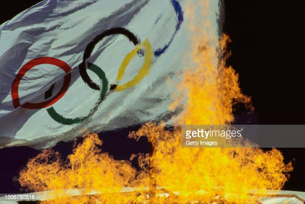 Flames from the cauldron rise in front of the official Olympic flag during the Opening Ceremony of the XXIV Summer Olympic Games on 17th September...