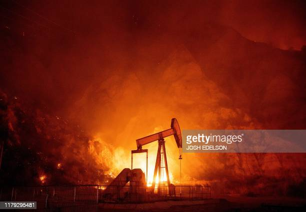 Flames from the Maria fire burn through an oil field in Santa Paula California late on October 31 2019