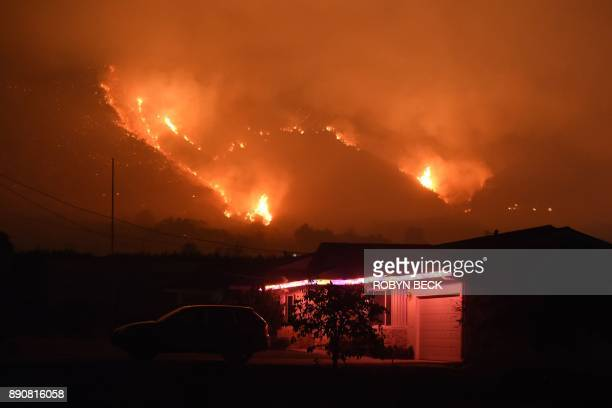 Flames from the Thomas Fire burn in the hills above Carpinteria California December 11 2017 The Thomas Fire in California's Ventura and Santa Barbara...