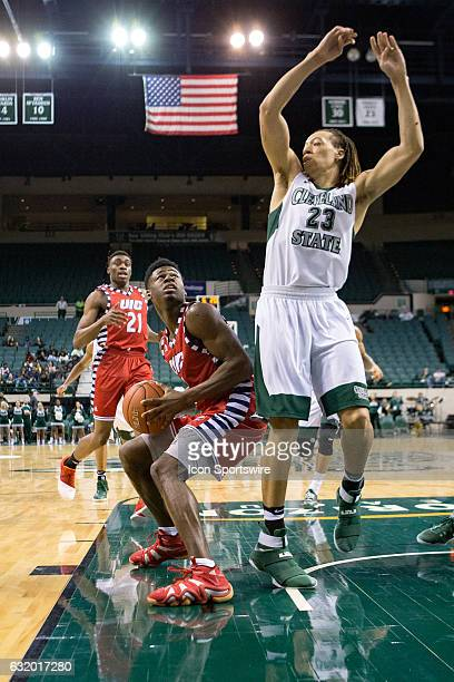 Flames G Michael Kolawole is defended by Cleveland State Vikings F Jamarcus Hairston during the second half of the NCAA Men's Basketball game between...