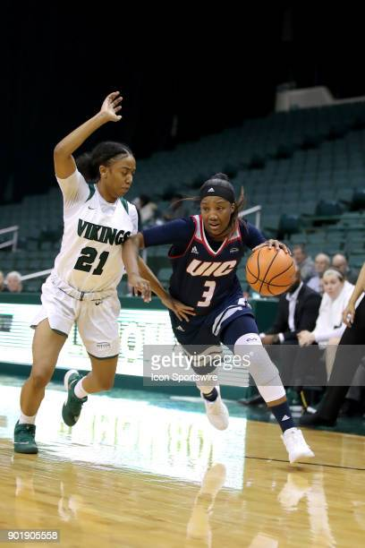 Flames guard Brittany Byrd drives to the basket as Cleveland State Vikings guard Jade Ely defend during the second quarter of the women's college...
