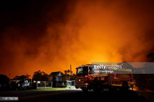 Flames illuminate the sky over a property on Putty road on November 15 2019 in Colo Heights Australia The warning has been issued for a 80000hectare...
