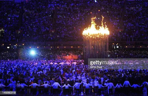 Flames leap from the cauldron during the Opening Ceremony of the London 2012 Olympic Games at the Olympic Stadium on July 27 2012 in London England