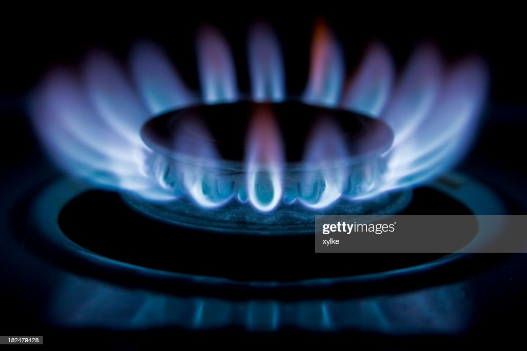 Flames of gas stove burner on high : Stock Photo