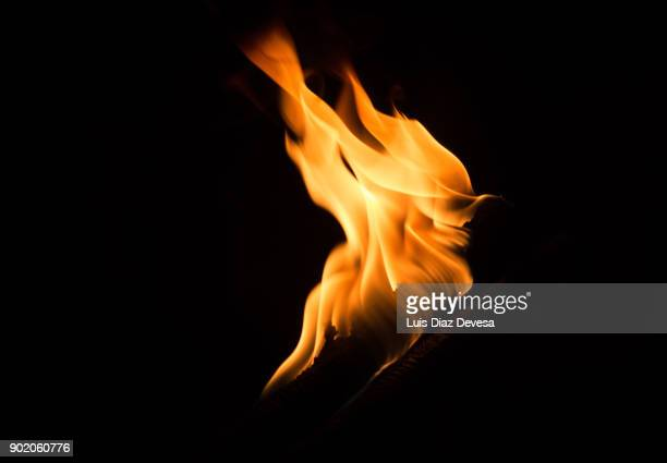 flames of orange reflections on a black background color - flame stock pictures, royalty-free photos & images