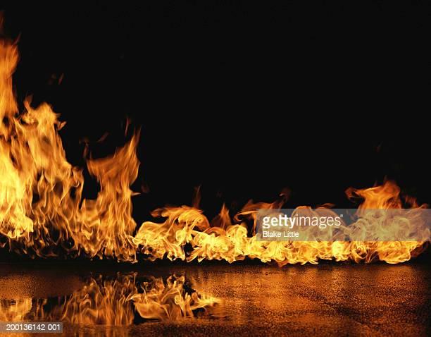 flames on concrete - 火 ストックフォトと画像