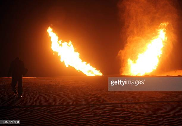 Flames raise from a pipeline that delivers gas to Israel and Jordan after it was hit by an explosion in the Al-Massaeed area, close to the town of...