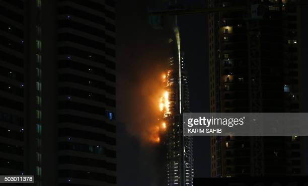 Flames rip through the Address Downtown hotel after it was hit by a massive fire near the world's tallest tower Burj Khalifa in Dubai on December 31...