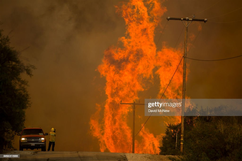 Flames rise as a fire front approaches the Lake Casitas area on December 8, 2017 near Ojai, California. Strong Santa Ana winds have been feeding major wildfires all week, destroying hundreds of houses and forcing tens of thousands of people to stay away from their homes.