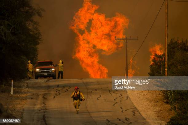 Flames rise as a fire front approaches the Lake Casitas area on December 8 2017 near Ojai California Strong Santa Ana winds have been feeding major...