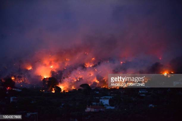 TOPSHOT Flames rise as a wildfire burns in the town of Rafina near Athens on July 23 2018