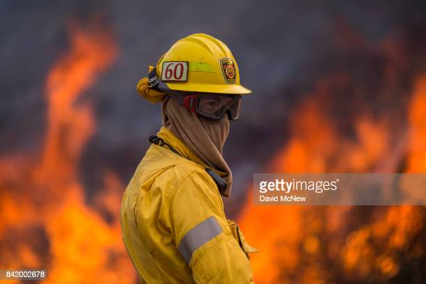 Flames rise behind a firefighter at the La Tuna Fire on September 2 2017 near Burbank California Los Angeles Mayor Eric Garcetti said at a news...