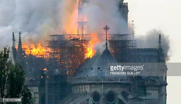 Flames rise during a fire at the landmark NotreDame Cathedral in central Paris on April 15 2019 afternoon potentially involving renovation works...