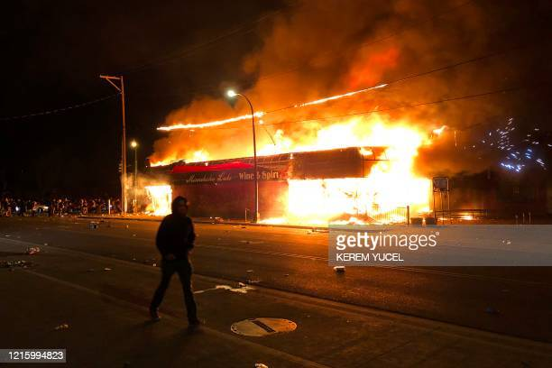Flames rise from a liquor store near the Third Police Precinct on May 28, 2020 in Minneapolis, Minnesota, during a protest over the death of George...