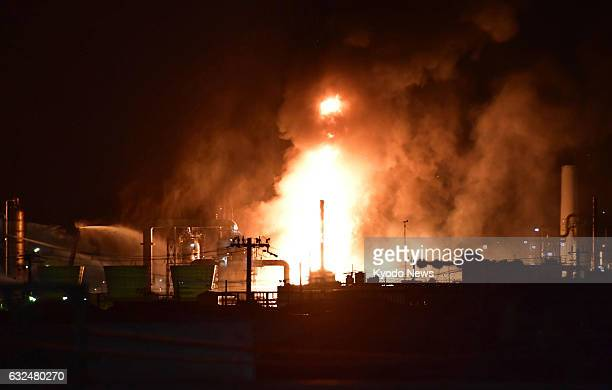 Flames rise from a TonenGeneral Sekiyu KK oil refinery in Arida Wakayama Prefecture western Japan on the night of Jan 22 after it broke out around...