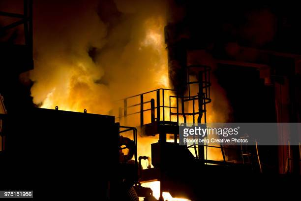 flames rise from an electric arc furnace (eaf) - electric arc furnace stock photos and pictures