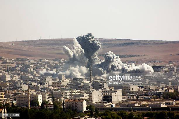 Flames rise from an explosion in the Syrian town of Kobane also known as Ain alArab after a USled coalition airstrike as it seen from the Turkish...