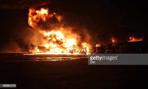 Flames rise from burning NATO supply oil tankers after an explosion in the town of Hub in restive Baluchistan province some 45 km from the port city...