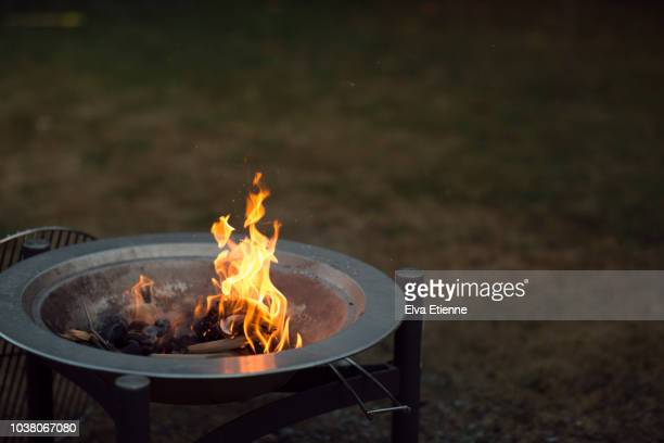 Flames rising from a barbecue grill