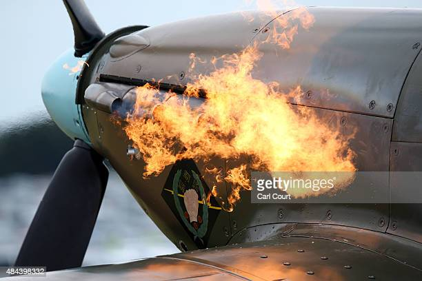 Flames roar from the engine cowling of a Hawker Hurricane as its engine is started on August 18 2015 in Biggin Hill England Aircraft including 18...