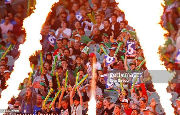 Flames shoot up as the crowd cheers after Glenn Maxwell of the Stars hit a six during the Big Bash League match between the Melbourne Stars and the...