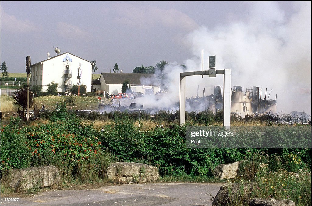Flames Smolder At The Site Of Wreckage An Air France Concorde Jet July 25