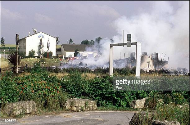 Flames smolder at the site of the wreckage of an Air France Concorde jet July 25 2000 that crashed shortly after take off in Gonesse France outside...