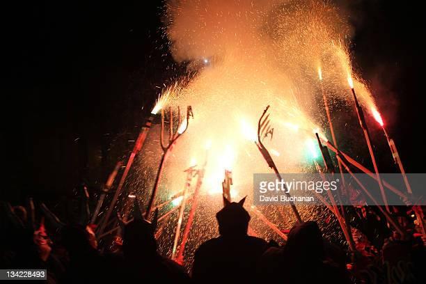 Flames sparks and pitchforks