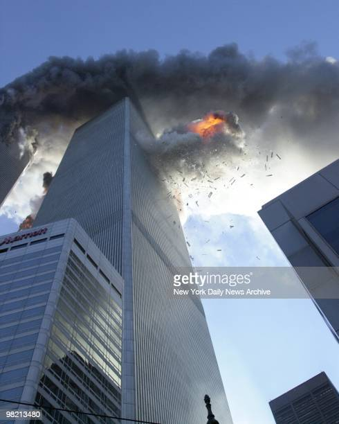 Flames spew out of 2 World Trade Center after it is struck by a commercial airliner in a terrorist attack on September 11 2001 in New York City A...