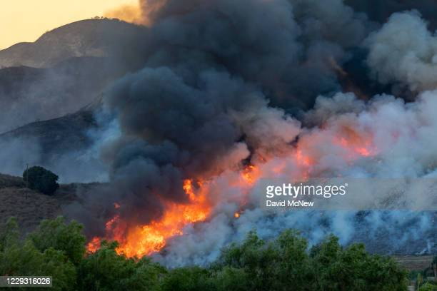Flames spread during the Blue Ridge Fire on October 27, 2020 in Chino Hills, California. Strong Santa Ana Winds gusting to more than 90 miles per...
