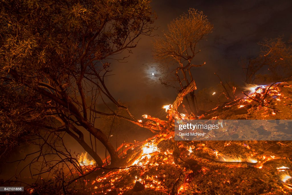 Flames spread on a moonlit night at the La Tuna Fire on September 2, 2017 near Burbank, California. Los Angeles Mayor Eric Garcetti said at a news conference that officials believe the fire, which is at 5,000 acres and growing, is the largest fire ever in L.A. People have been evacuated from hundreds of homes in Sun Valley, Burbank and Glendale. About 100 Los Angles firefighters are expected to return soon from Texas, where they've been helping survivors from Hurricane Harvey.