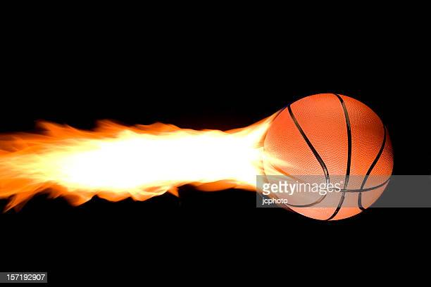 flaming basketball - march madness basketball stock photos and pictures