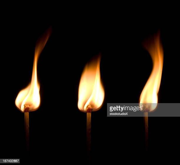Flaming match trio