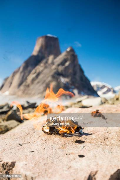 flaming pile of toilet paper in remote mountains, leave no trace. - leave_no_trace stock pictures, royalty-free photos & images