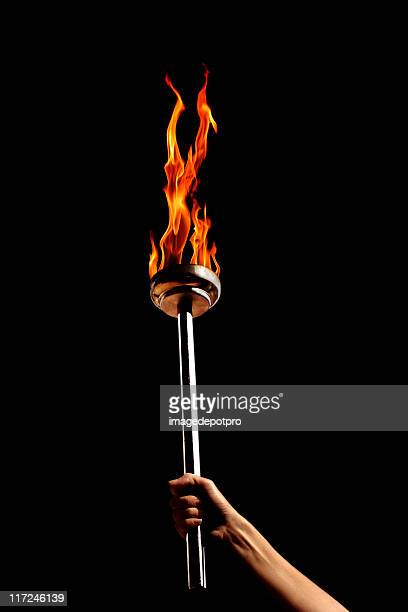 flaming torch - flame stock pictures, royalty-free photos & images