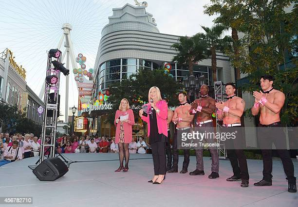 Flamingo Las Vegas Headliner Olivia NewtonJohn Flamingo Regional President Eileen Moore and cast members of Chippendales light the High Roller pink...