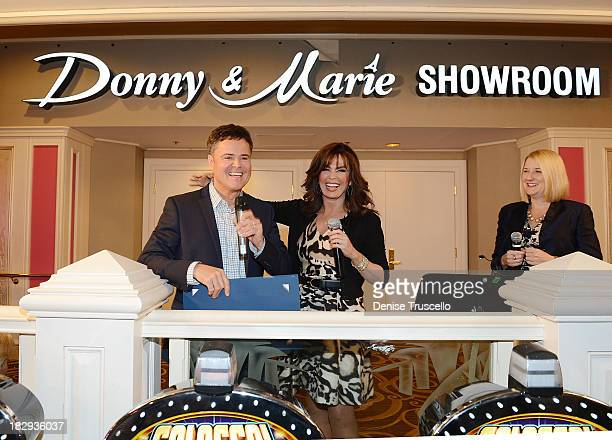 Flamingo Las Vegas Regional President Eileen Moore Donny Osmond and Marie Osmond unveil the signage for the newlyrenamed Donny Marie Showroom at...