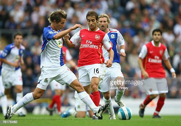 Flamini of Arsenal battles with Morten Gamst Pedersen of Blackburn during the Barclays Premiership League match between Blackburn Rovers and Arsenal...