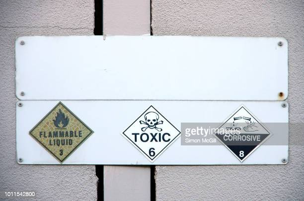 flammable liquid 3, toxic 6 and corrosive liquid 8 signs on the exterior wall of a building - flammable stock photos and pictures