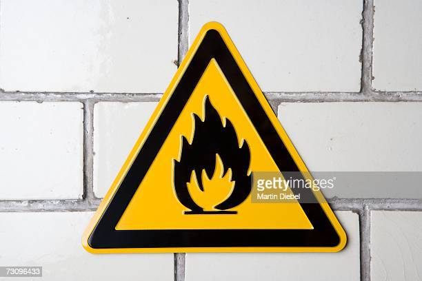 ?flammable? warning sign on wall - flammable stock photos and pictures