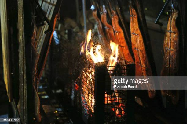 flammlachs fire-roasted salmon at hamburg christmas market - smoked food stock photos and pictures