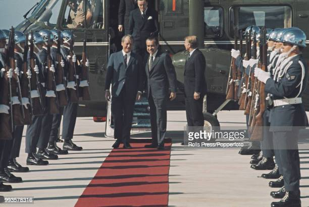 Flanked by a military guard of honor President of the United States Richard Nixon on right welcomes Chancellor of Germany Willy Brandt on his arrival...