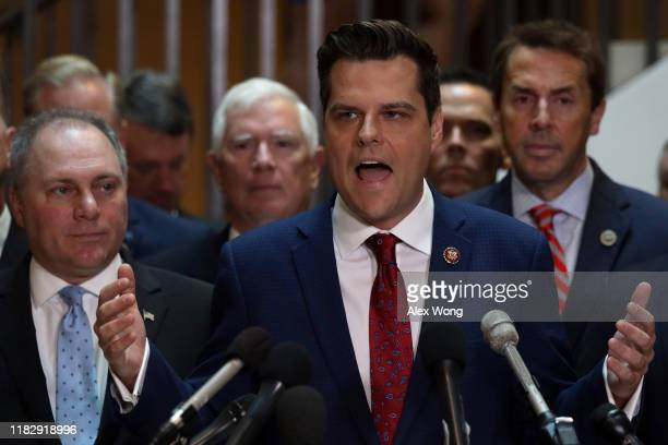 Flanked by about two dozen House Republicans US Rep Matt Gaetz speaks as House Minority Whip Rep Steve Scalise listens during a press conference at...
