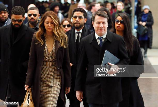 Flanked by attorneys and supporters, actor Jussie Smollett arrives at the Leighton Criminal Courthouse on February 24, 2020 in Chicago, Illinois....