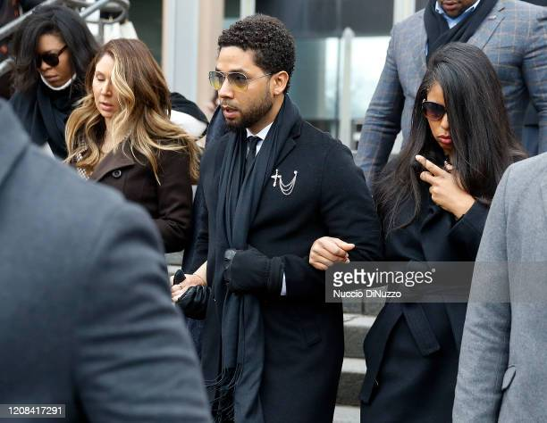 Flanked by attorneys and supporters, actor Jussie Smollett walks out of the Leighton Criminal Courthouse today after pleading not guilty to a new...