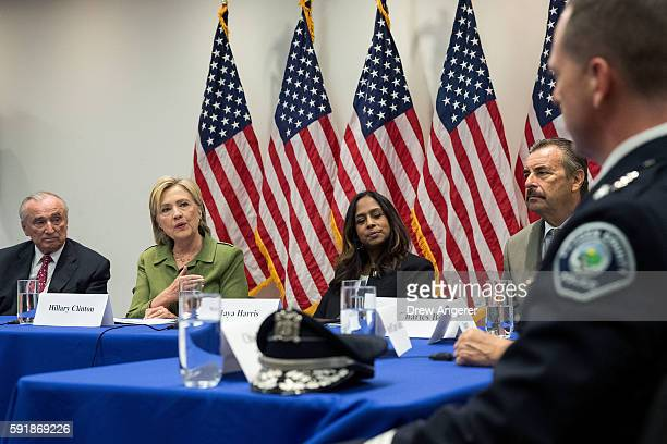 Flanked by Bill Bratton commissioner of the New York City Police Department and policy advisor Maya Harris look on as Democratic presidential...