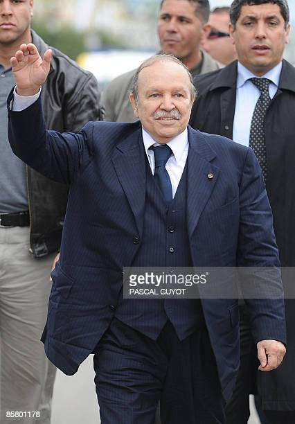 Flanked by bodyguards Algerian President Abdelaziz Bouteflika gestures to his supporters during an election campaign rally on April 04 2009 in Annaba...