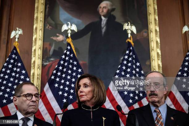 Flanked by Chairman of House Judiciary Committee Rep Jerry Nadler and Chairman of House Foreign Affairs Committee Eliot Engel Speaker of the House...